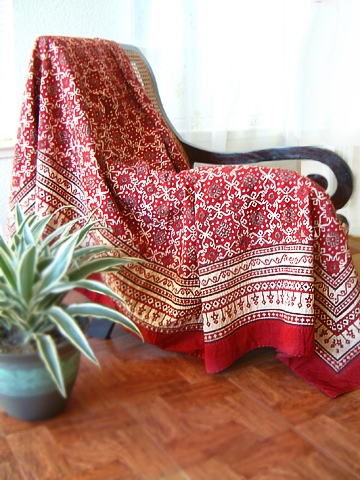 Red bedspread quilted by hand