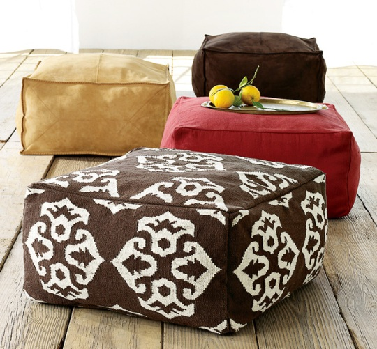 brown and red floor pillows