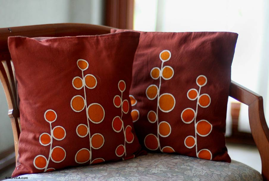 red and orange decorative pillows
