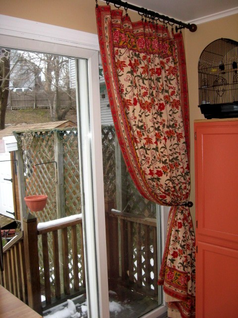 floral curtains used as a patio door panel