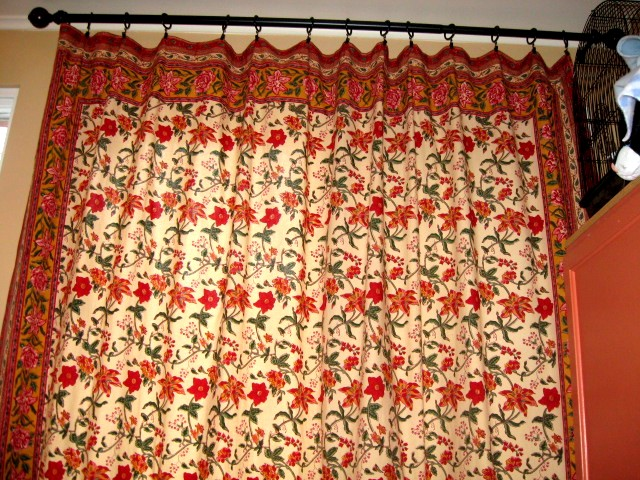 floral bedspread and patio door cover