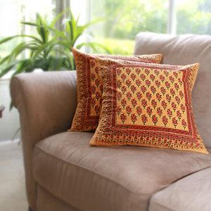 decorative orange paisley throw pillows