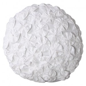 white round floral pillow