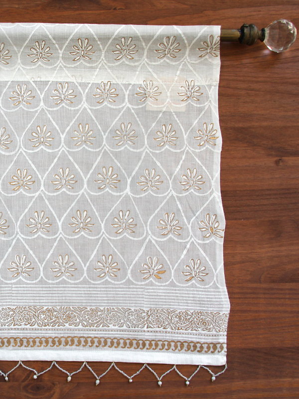 sheer white valance with beads and gold trim