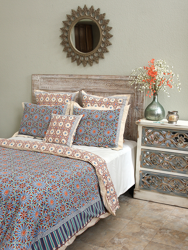 blue bedding with flower print in moroccan tile pattern