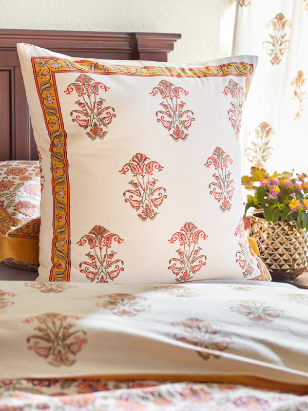 Orange floral Moroccan style pillows for a Moroccan bedroom