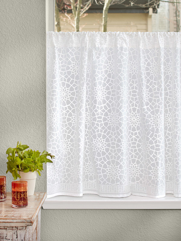 white curtains in a Moroccan pattern for a Moroccan style kitchen