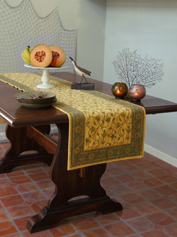 A yellow table runner serves as yellow room decor in a beach house.