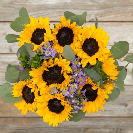 bouquet of sunflowers with purple flowers and greens