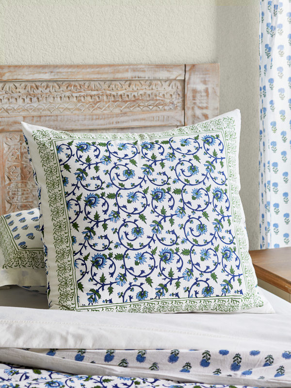 throw pillow cover in white, green, and blue floral pattern with vines