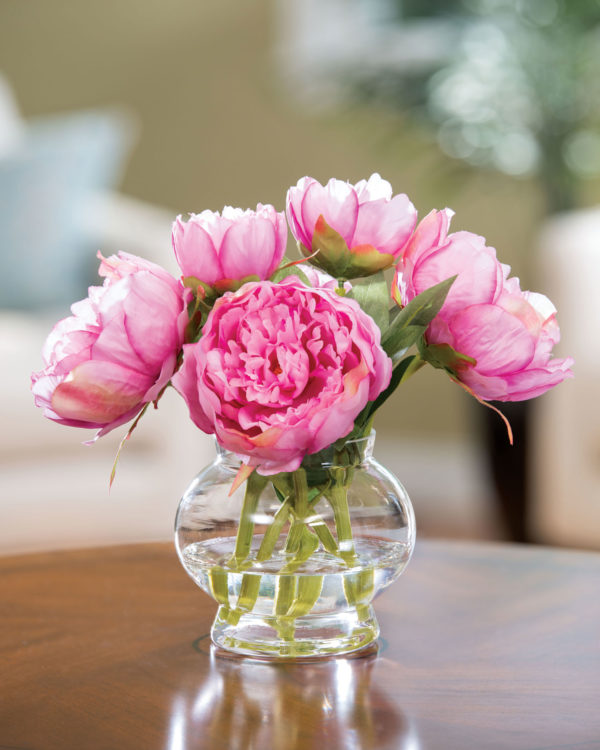 pink silk peonies pop when paired with a blue floral pattern fabric