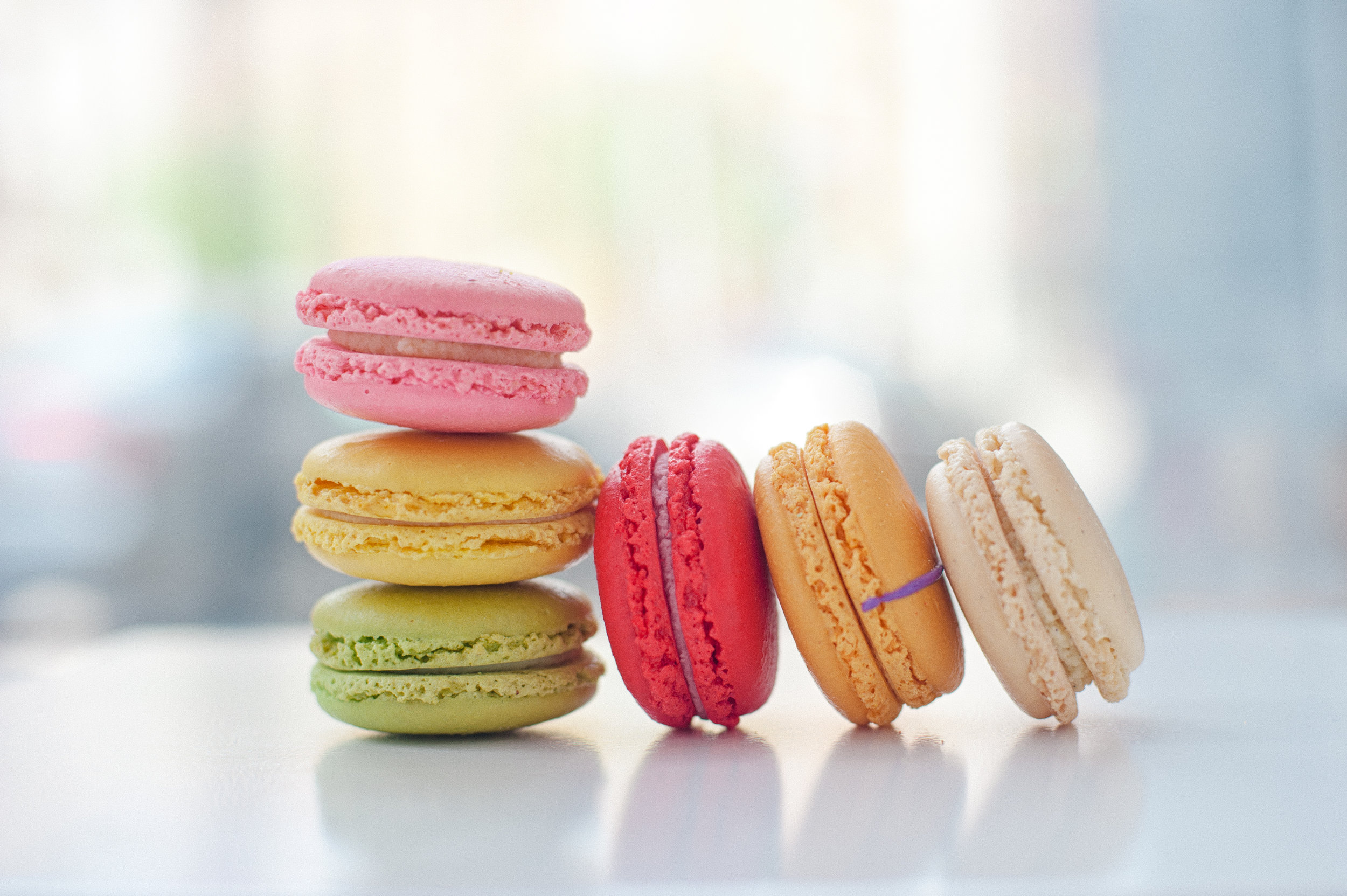macarons in vivid sahdes of pink, orange, red, and green