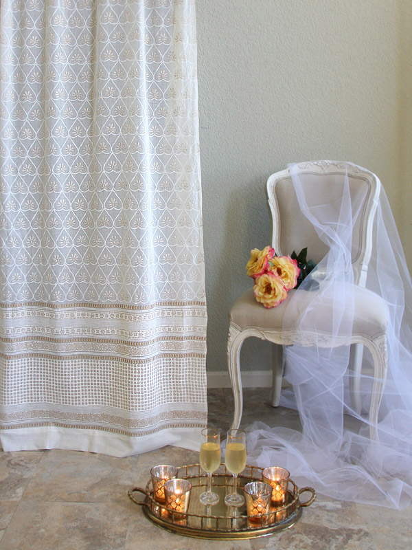 white sheer curtains with pattern and gold accent