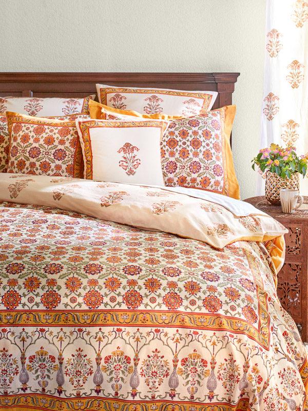 orange bedding with floral pattern