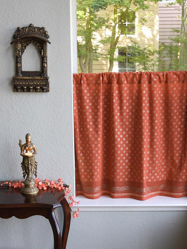 orange curtain with gold Indian print as an orange kitchen curtain or bathroom curtain