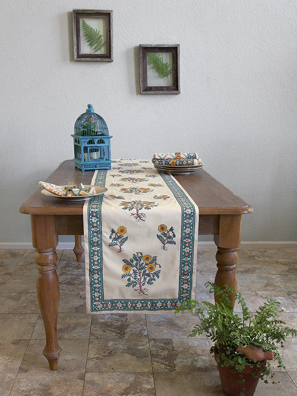 A floral pattern of California poppies graces a floral table runner.