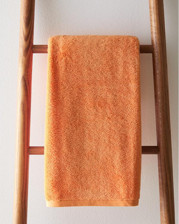 Orange towel for red bathroom