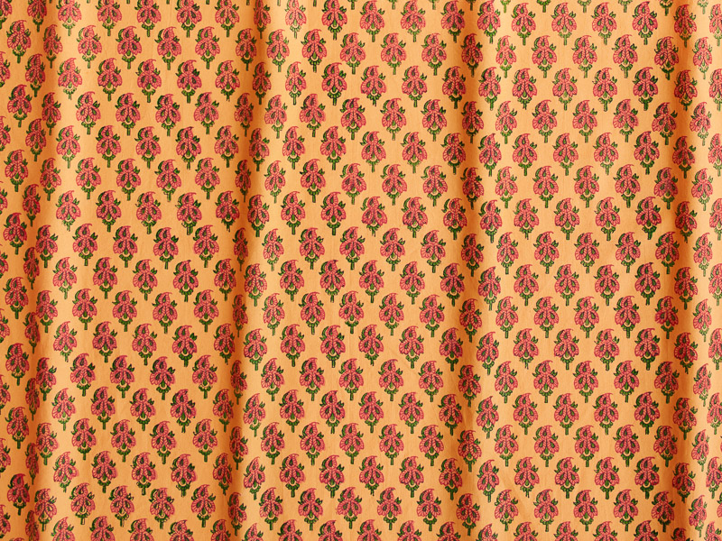 Indian fabric swatch, mango colored with small floral paisley print