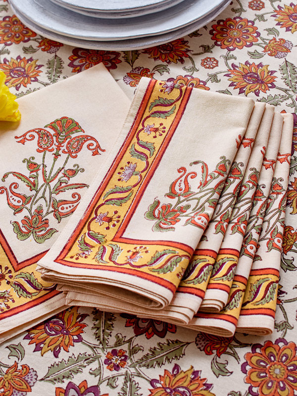 Orange floral napkins go with a variety of Thanksgiving tablecloths