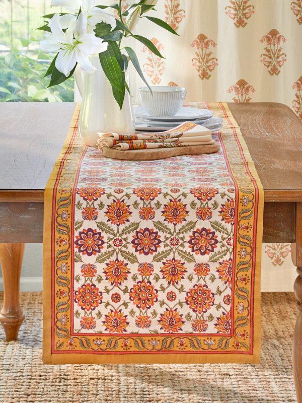 orange table runner for orange decor in the dining room