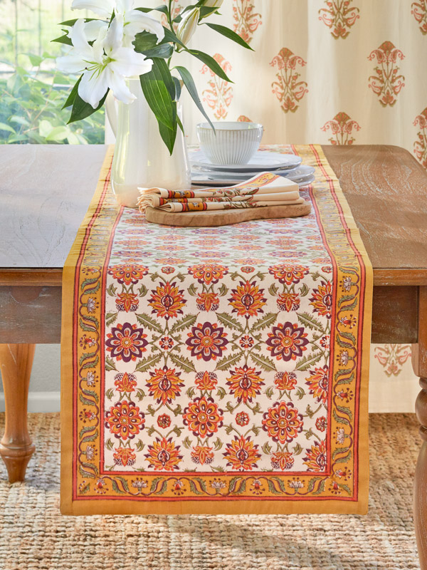 An orange floral table runner makes a great Thanksgiving table runner