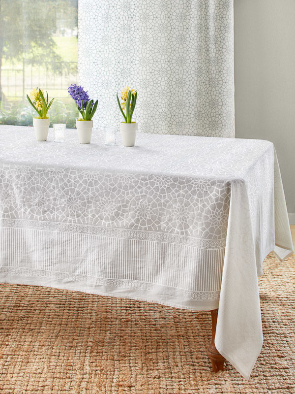 Spring flowers and a white tablecloth cover the table.