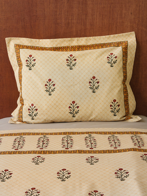 Block print floral pillowcase with red poppies on apricot ground