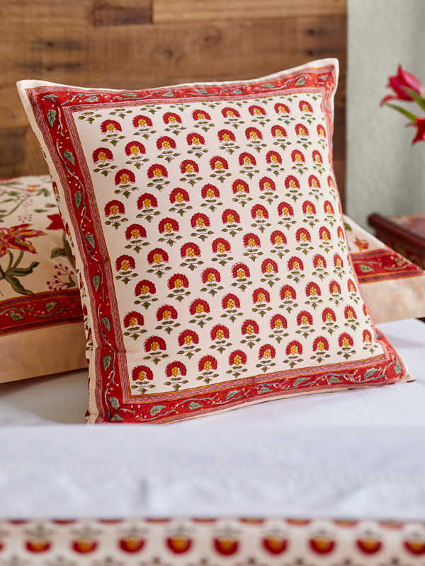 red floral pillow in a tropical house