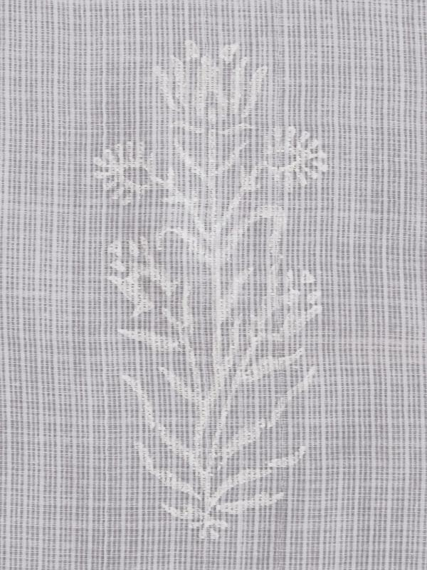 a white flower pattern on white cotton voile