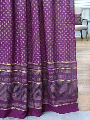 Gold and purple curtains with a classic Indian print in a zen room