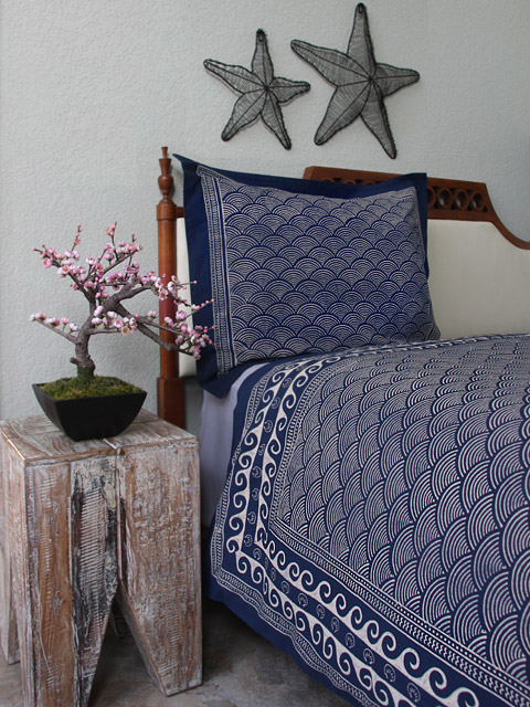 Nautical navy blue bedding with waves and crests is block printed by hand with craftsmanship.