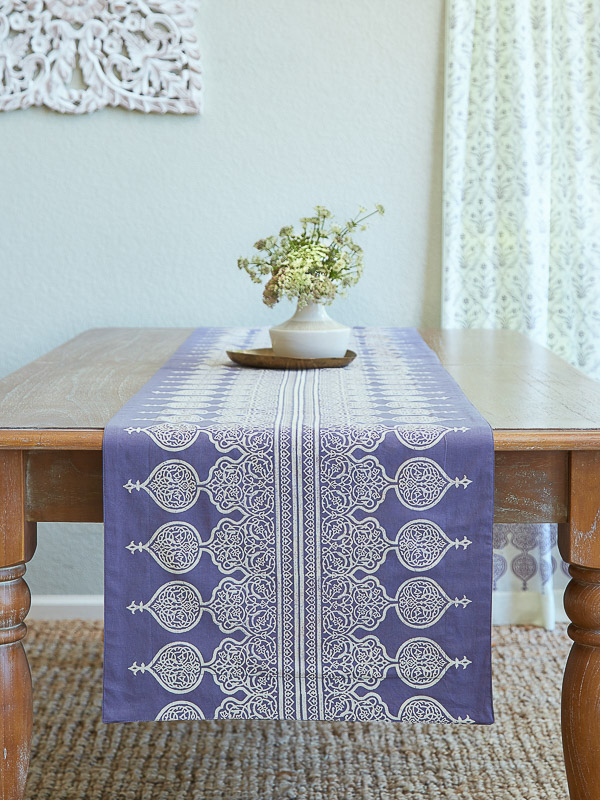 lilac color block print table runner with spring flowers as a centerpiece over a wooden table