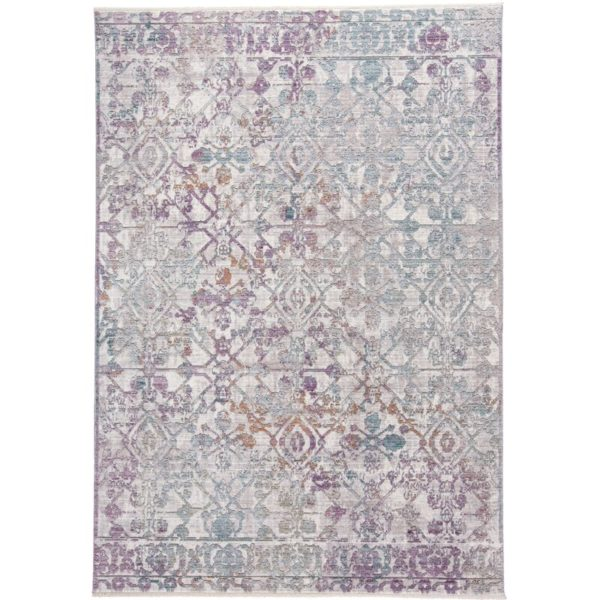 faded boho throw rug with shades of grey, blue, rust, and lilac color