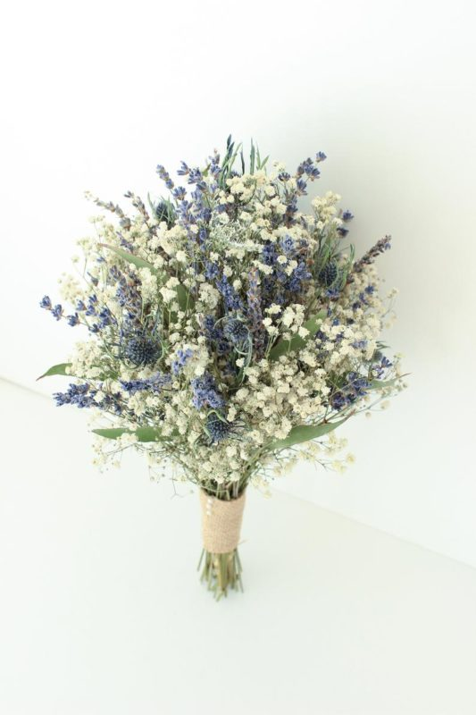 cream, blue, and lilac color dried floral bouquet