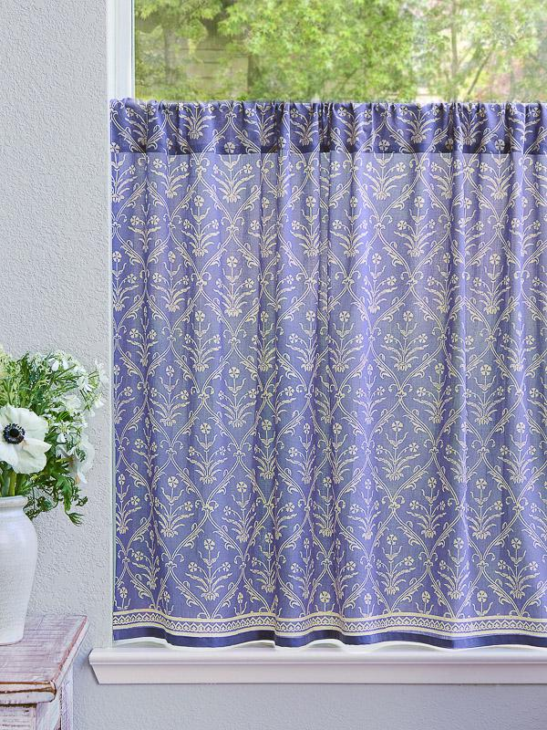 purple kitchen curtain, a cafe curtain in a lilac color with white floral pattern and bouquet of anemones on the side