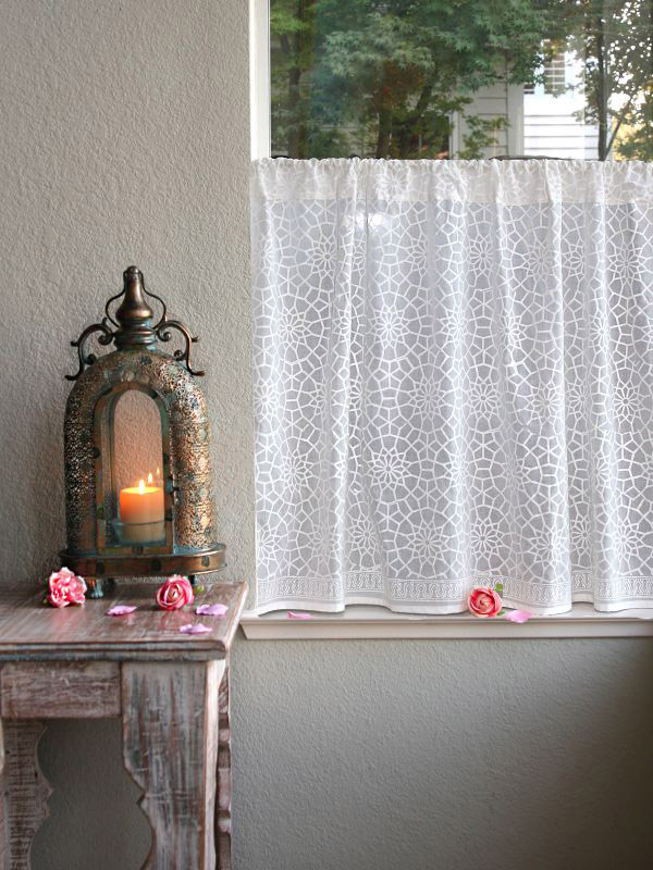 white cafe curtain or white bathroom curtain with a Moroccan pattern