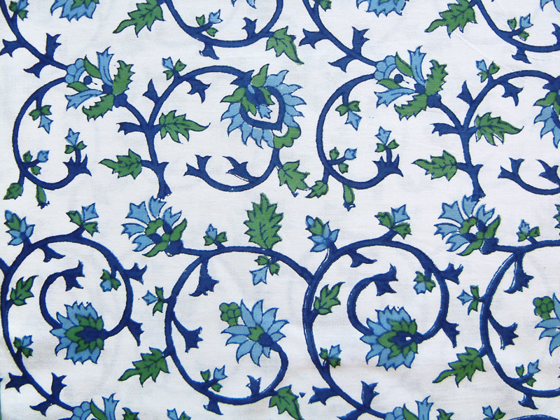 fabric swatch in turquoise, lapis and deep green vines are set against a milky white ground