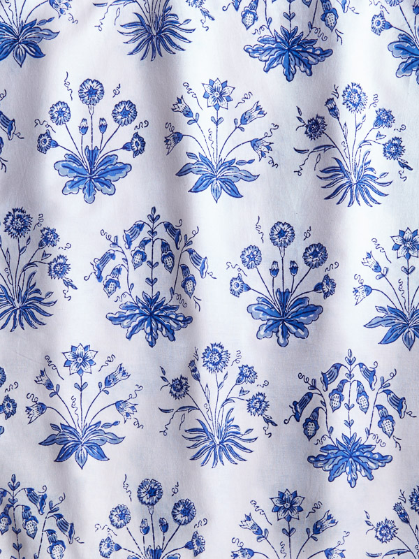 a blue and white flower pattern fabric swatch