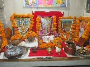 diwali celebrations alter decorated with flowers