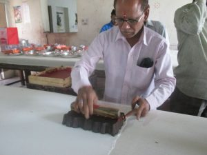 Rafiq Bahi our senior most artisan, printing the first block on the communal yardage that is traditionally printed on Lakshmi Pooja