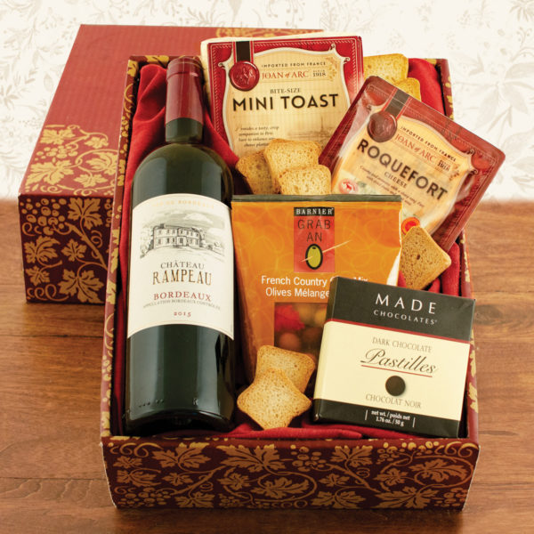 wine baskets with cheese and snacks are meaningful Mother's day gifts for wine lovers