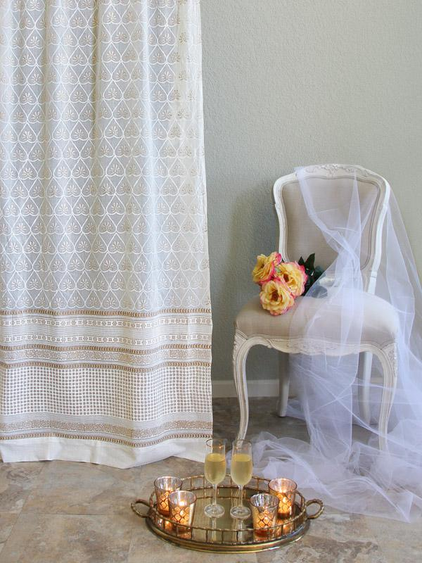 White and gold curtains are gauzy and beautiful in a glam living room