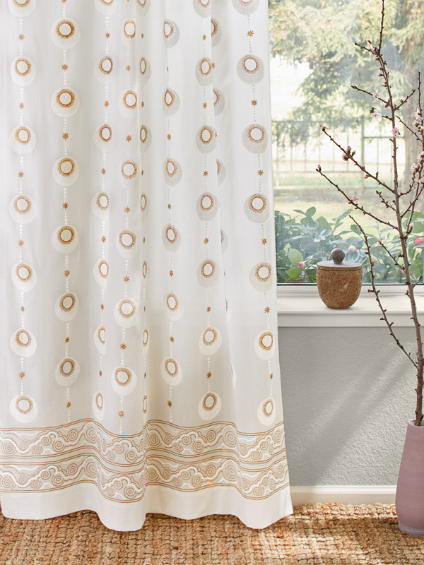 white and gold curtains with a celestial print are the perfect bohemian curtains in a glam living room
