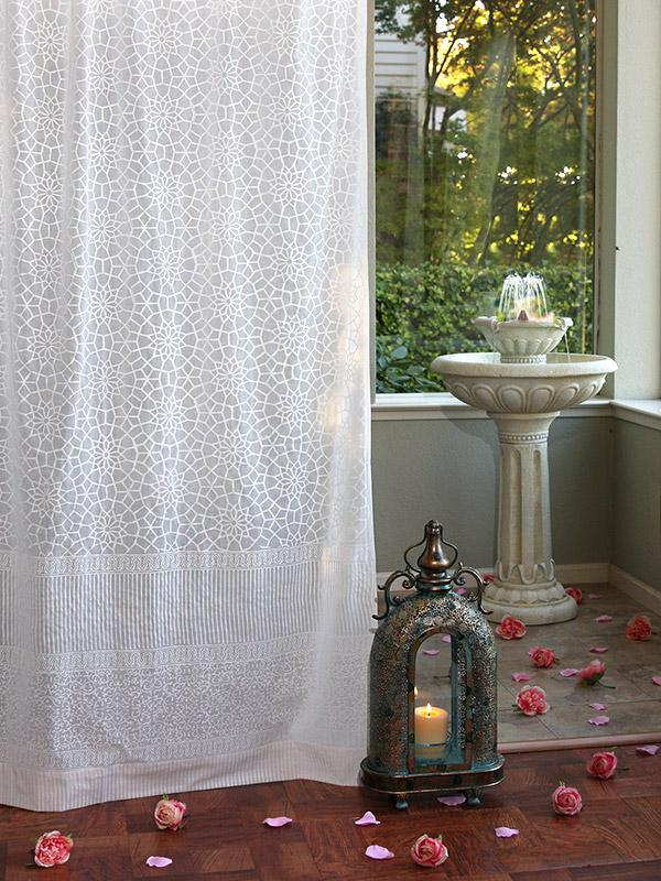 White farmhouse curtains with a geometric print on block printed fabric