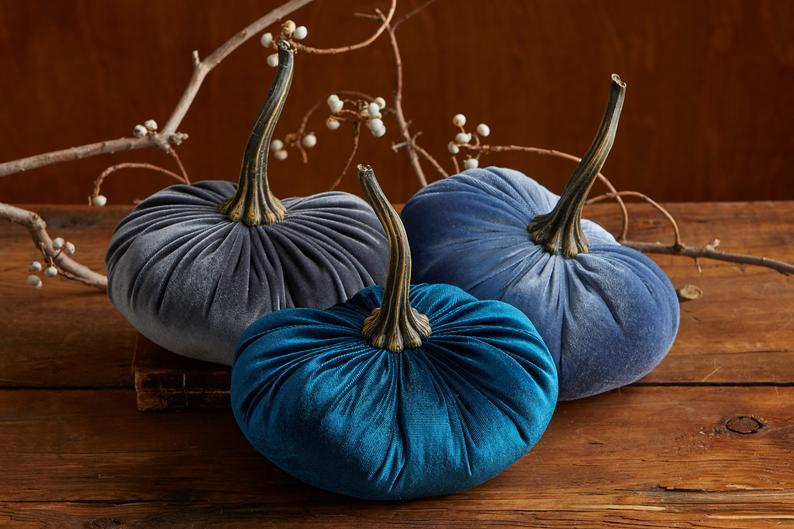 blue velvet pumpkins go with dark blue duvet cover in a cozy bedroom