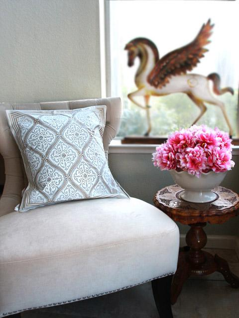 A block printed fabric white and gold throw pillow is an elegant fall pillow