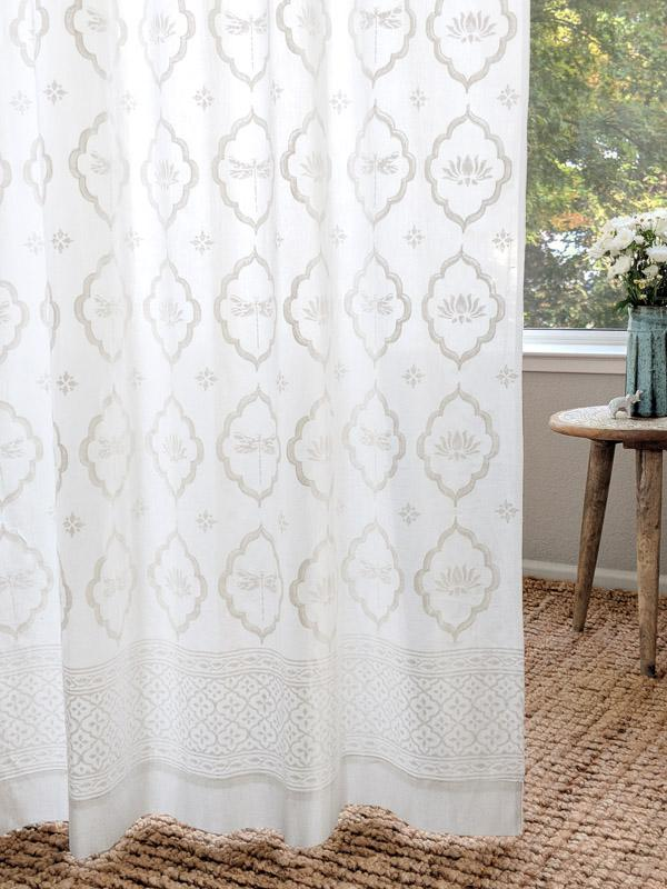 white farmhouse curtains with a dragonfly