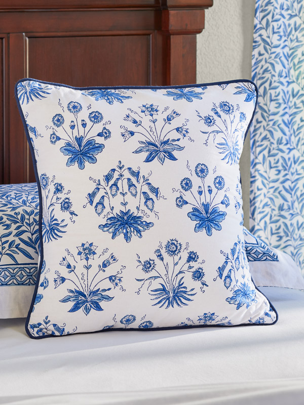 cottage style blue and white throw pillow cover with floral pattern