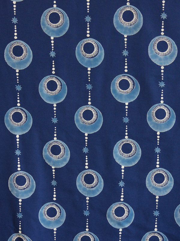 Indigo blue fabric swatch with bohemian print and cosmic pattern
