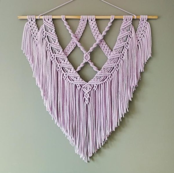 a lilac macrame wall hanging for a boho bedroom or romantic bedroom